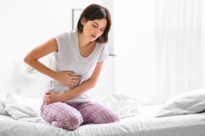 Dolor de estomago en la mujer